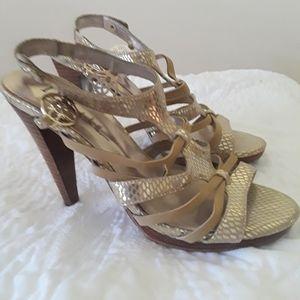 Nicole Miller gold sandals.